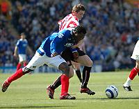 Tony Oudot / Digitalsport<br /> FA Barclays Premiership<br /> Portsmouth v Sunderland<br /> 22nd April, 2006<br /> Benjani Mwaruwari of Portsmouth beats off a challenge from George McCartney of Sunderland