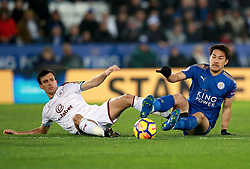 """Leicester City's Shinji Okazaki (right) and Burnley's Jack Cork battle for the ball during the Premier League match at the King Power Stadium, Leicester. PRESS ASSOCIATION Photo Picture date: Saturday December 2, 2017. See PA story SOCCER Leicester. Photo credit should read: Mike Egerton/PA Wire. RESTRICTIONS: EDITORIAL USE ONLY No use with unauthorised audio, video, data, fixture lists, club/league logos or """"live"""" services. Online in-match use limited to 75 images, no video emulation. No use in betting, games or single club/league/player publications."""