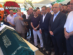 June 23, 2017 - Istanbul, Turkey - June 23, 2017 - Istanbul, Turkey - Former journalist turned CHP lawmaker Enis Berberoglu (Second, right), escorted by Turkish gendarme and police officers, takes part in his stepfather's funeral on June 23, 2017 in Istanbul. Turkey's main opposition leader, Republican People's Party (CHP) leader Kemal Kilicdaroglu, called for a 'walk of justice' after former journalist turned CHP lawmaker Enis Berberoglu was sentenced to 25 years in jail on June 14, 2017 for leaking classified information to a newspaper. (Credit Image: © Depo Photos via ZUMA Wire)