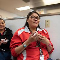 Angel Darwin sampling food made during Andi Murphy's cooking demo Friday, Feb. 1 at Navajo Technical University.