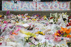 © Licensed to London News Pictures. 23/06/2016. Birstall, UK. A thank you sign stands with flowers in Birstall, West Yorkshire, a week to the day that Labour MP was shot and killed in the town. A one minutes silence was held at 13.50, the time that Jo was attacked last week outside her constituency surgery . Photo credit : Ian Hinchliffe/LNP