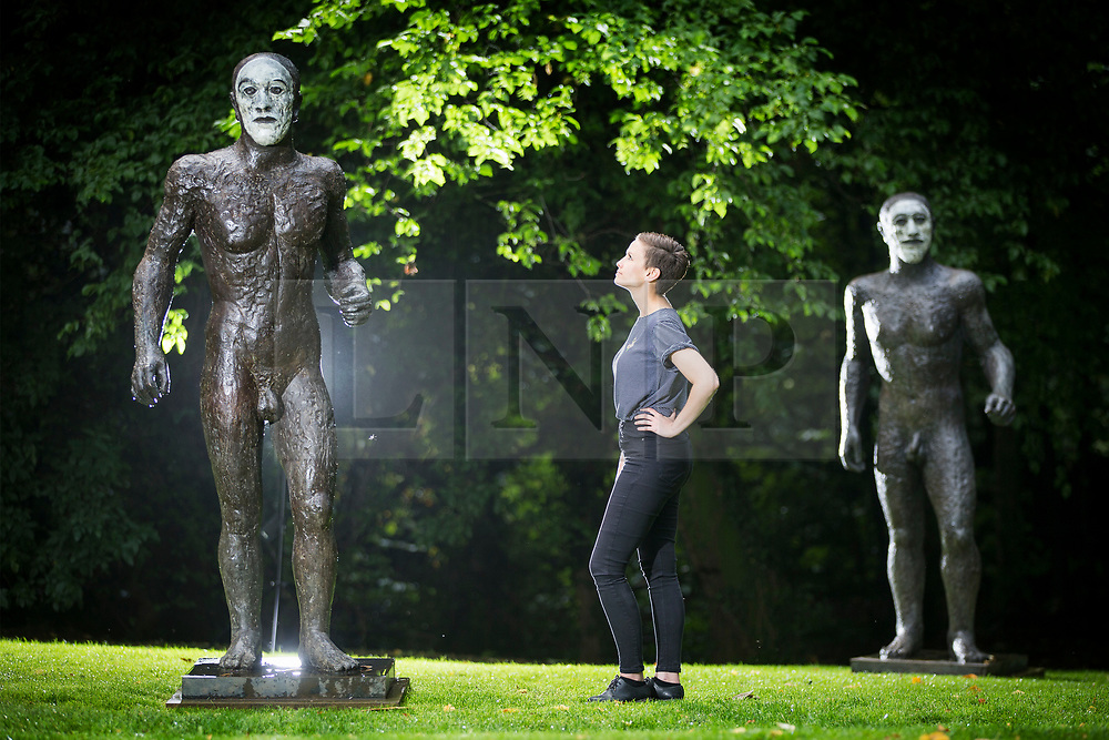 © Licensed to London News Pictures. 06/09/2017. Wakefield UK. Kerry Chase looks at the Elizabeth Frink sculpture 'The Riace Figures' from 1986 that has been placed on display at the Yorkshire Sculpture Park as part of their 40th anniversary celebrations. The work illustrates Frink's appreciation of the male figure for it's potency & vulnerability. Photo credit: Andrew McCaren/LNP