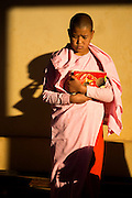 Nun in deep thought and shadows, Taunggyi