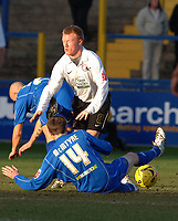 Photo: Paul Greenwood.<br />Macclesfield Town v Hereford United. Coca Cola League 2. 20/01/2007. Hereford's Andy Ferrell winces as he is challenged by Kevin McIntyre