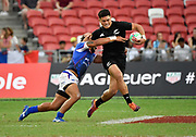 New Zealand's Tone Ng Shiu is held by Samoa's Elisapeta Alofipo during the HSBC Singapore Rugby Sevens 5th Place Play-off - Samoa v New Zealand won by Samoa 19-17 at The National Stadium, Singapore, Sunday, April 14th, 2019. (Steve Flynn/Image of Sport)