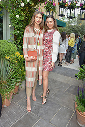 Left to right, Sabrina Percy and Amber le Bon at The Ivy Chelsea Garden Summer Party ,The Ivy Chelsea Garden, King's Road, London, England. 14 May 2019. <br /> <br /> ***For fees please contact us prior to publication***