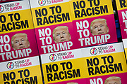 Bo to Trump, no to racism placards during protests against the state visit of US President Donald Trump on 4th June 2019 in London, United Kingdom. Organisers Together Against Trump which is a collaboration between the Stop Trump Coalition and Stand Up To Trump, have organised a carnival of resistance, a national demonstration to protest against President Trump's policies and politics during his official UK visit.