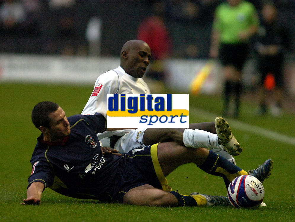 Photo: Matt Bright/Sportsbeat Images.<br />Milton Keynes Dons v Accrington Stanley. Coca Cola League 2. 08/12/2007.<br />Lloyd Dyer of MK Donsis tackled by Phil Edwards of Accrington