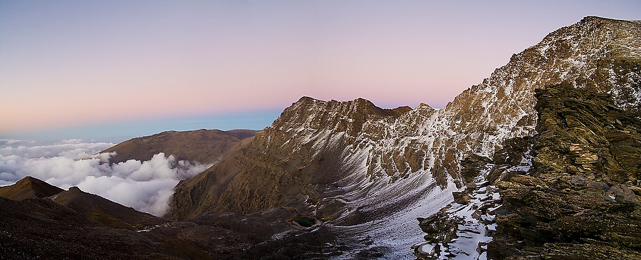 Mulhacen, lightly dusted in snow at sunset, Sierra Nevada National Park, Andalusia, Spain. Mulhacen is the highest mountain in continental Spain and in the Iberian Peninsula.