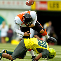 Beavers quarterback Lyle Movao fumbles the ball in the first quarter. The Civil War waged Saturday, December 1,  2007 at Autzen Stadium as Oregon Ducks battled Oregon State Beavers at their 111th matchup. (The Columbian/ N. Scott Trimble)