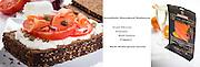 open faced smoked salmon over goat cheese,tomato,peppercorn,red onion,on multi grain bread