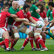 Luke Charteris, Wales, hands the ball off to team mate Toby Faletau  during the Ireland V Wales Quarter Final match at the IRB Rugby World Cup tournament. Wellington Regional Stadium, Wellington, New Zealand, 8th October 2011. Photo Tim Clayton...