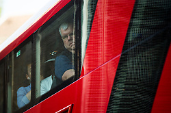 © Licensed to London News Pictures. 09/07/2015. London, UK. A distressed looking commuter onboard a bus at Victoria Station. Commuters stranded at Victoria Station in London on the day of a network wide tube strike which finishes at 9.30 this evening. Photo credit: Ben Cawthra/LNP