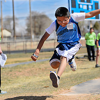 040814       Cable Hoover<br /> <br /> Noah Grayson gets some encouragement as he competes in the long jump during the Navajo Nation Special Olympics at Window Rock High School in Fort Defiance Wednesday.