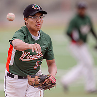 Wingate Bear Jordan Ashley (5) pitches to the Miyamura JV Patriots Friday at Ford Canyon Park.
