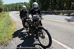 Norm Nelson of Florida gets help pushing his 1911 Reading Standard from a random passerby, as he ran out of steam going up a steep incline during the Motorcycle Cannonball Race of the Century. Stage-3 from Morgantown, WV to Chillicothe, OH. USA. Monday September 12, 2016. Photography ©2016 Michael Lichter.
