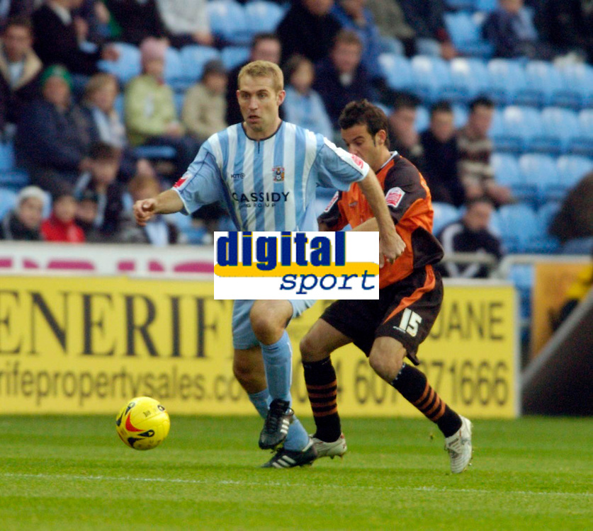 Photo: Leigh Quinnell.<br /> Coventry City v Ipswich Town. Coca Cola Championship.<br /> 19/11/2005. Coventrys James Scowcroft moves away from Ipswichs' Sito Castro.