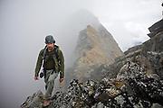 Craig Weiland hikes up a high ridge in the Talkeetna Mountains near Hatcher Pass, Alaska.