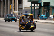 A coco taxi drives along the malecon in Havana, Cuba on Saturday June 28, 2008.