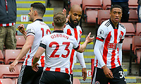 Sheffield United's David McGoldrick celebrates scoring the opening goal with Ben Osborn<br /> <br /> Photographer Alex Dodd/CameraSport<br /> <br /> The Premier League - Sheffield United v Burnley - Sunday 23rd May 2021 - Bramall Lane - Sheffield<br /> <br /> World Copyright © 2021 CameraSport. All rights reserved. 43 Linden Ave. Countesthorpe. Leicester. England. LE8 5PG - Tel: +44 (0) 116 277 4147 - admin@camerasport.com - www.camerasport.com