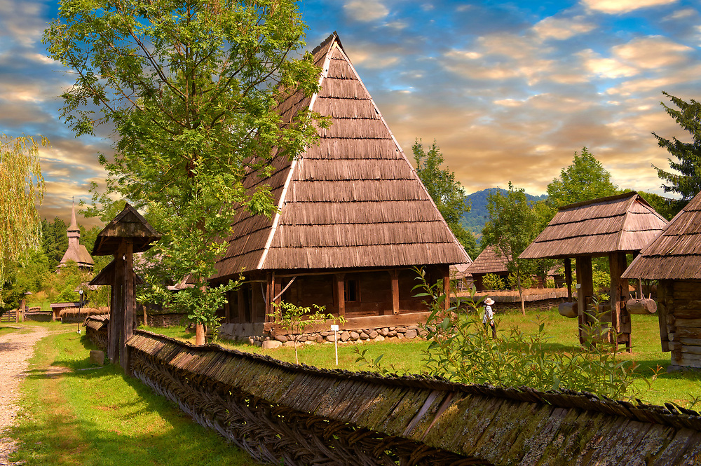 19th century traditional farm house of the Iza Valley, The Village museum near Sighlet, Maramures, Northern Transylvania .<br /> <br /> Visit our ROMANIA HISTORIC PLACXES PHOTO COLLECTIONS for more photos to download or buy as wall art prints https://funkystock.photoshelter.com/gallery-collection/Pictures-Images-of-Romania-Photos-of-Romanian-Historic-Landmark-Sites/C00001TITiQwAdS8