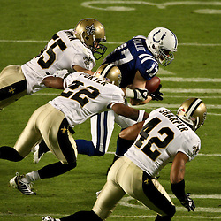 2010 February 07: New Orleans Saints linebacker Scott Fujita (55) and cornerback Tracy Porter (22) and safety Darren Sharper (42) pursue Indianapolis Colts wide receiver Austin Collie (17) during a 31-17 win by the New Orleans Saints over the Indianapolis Colts in Super Bowl XLIV at Sun Life Stadium in Miami, Florida.