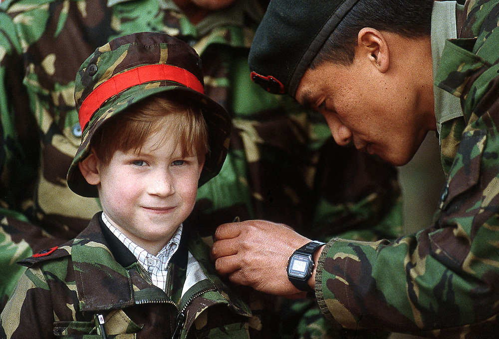 Prince Harry seen being presented with a special badge during a visit to the Gurkha Regiment on Salisbury Plains, Uk.1988