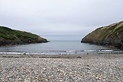 View from a pebble beach along the coastal path on 17th August 2021 in Newport, Pembrokeshire, Wales, United Kingdom. Newport is a town, parish, community, electoral ward and ancient port of Parrog, on the Pembrokeshire coast in West Wales at the mouth of the River Nevern in the Pembrokeshire Coast National Park.