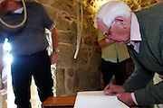 Isles of Scilly, 21 May 2009: After ring the first touch of plain bob triples, Brian Horrell signs the visitor's book at  the tower of the Parish Church of St Mary's, Hugh Town, on the Isles of Scilly. Photo by Peter Horrell / http://peterhorrell.com