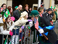 March 16, 2013 - New York, NY, U.S. - 'Leprechaun' NOEL RYAN, an alumnus of Quinnipiac College, kisses hand of young girl in crowd at the 252nd annual NYC St. Patrick's Day Parade. Thousands of marchers show their Irish pride, as they march up Fifth Avenue, and over a million people, often in green and orange, watch and celebrate.