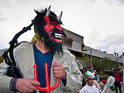 """03 DECEMBER 2011 - PHOENIX, AZ:   A demon, who threatens the Virgin and other innocents, in a procession to honor the Virgin of Guadalupe in Phoenix Saturday. Matachine dancers protect the Virgin from the Demon. The Phoenix diocese of the Roman Catholic Church held its Sixth Annual Honor Your Mother Day Saturday to honor the Virgin of Guadalupe. According to Mexican Catholic tradition, on December 9, 1531 Juan Diego, an indigenous peasant, had a vision of a young woman while he was on a hill in the Tepeyac desert, near Mexico City. The woman told him to build a church exactly on the spot where they were standing. He told the local bishop, who asked for some proof. He went back and had the vision again. He told the lady that the bishop wanted proof, and she said """"Bring the roses behind you."""" Turning to look, he found a rose bush growing behind him. He cut the roses, placed them in his poncho and returned to the bishop, saying he had brought proof. When he opened his poncho, instead of roses, there was an image of the young lady in the vision. The Virgin is now honored on Dec 12 in Catholic churches throughout Latin America and in Hispanic communitied in the US.   PHOTO BY JACK KURTZ"""