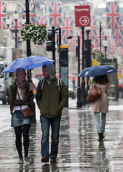 © licensed to London News Pictures. London, UK 11/06/2012. People walking in heavy rain in Regent Street, today (11/06/12). Photo credit: Tolga Akmen/LNP