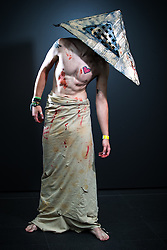 © Licensed to London News Pictures . 26/07/2015 . Manchester , UK . Portrait : PYRAMID HEAD ( Dan Silver , 20 , from Harrogate ) at the venue . Comic Con convention at Manchester Central Convention Centre . Photo credit : Joel Goodman/LNP