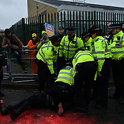 Police arrested a activist pour some red paint on the streeet outside Woolwich Crown Court on an extradition hearing of WikiLeaks Founder Julian Assange on 24th Feb 2020, London, UK.