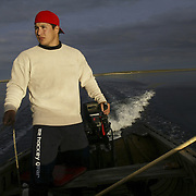 Jordin Tootoo, the first Inuit drafted into the National Hockey League, hunting seal near the Arctic Circle. Photographed for Sports Illustrated <br /> <br /> Image available for licensing and for a personal print. Please Add To Cart and select the size and finish. All prints are delivered directly to you from the printer.