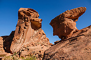 Arch Rock Campground, Valley of Fire State Park, Moapa Valley, Nevada, USA. Starting more than 150 million years ago, great shifting sand dunes during the age of dinosaurs were compressed, uplifting, faulted, and eroded to form the park's fiery red sandstone formations.