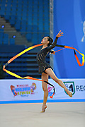 """Lu Serena during ribbon routine at the International Tournament of rhythmic gymnastics """"Città di Pesaro"""", April 11,2015. Serena born on April 30, 1998 in  Minneapolis, is a rhythmic gymnast of Usa.<br /> This tournament dedicated to the youngest athletes is at the same time of the World Cup."""