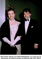 MISS FIONA AITKEN and LORD PORCHESTER, son of the Earl of Carnarvon, at a ball in London on February 6th 1997. LWH 2