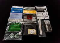 unused new trial covid19 home testing kit. nose and throat swab and saliva photo by mark anton smith