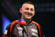 Nathan Aspinall being interviewed after his match against Michael Van Gerwen during the PDC Unibet Premier League darts at Marshall Arena, Milton Keynes, United Kingdom on 24 May 2021.
