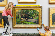 The return and rehanging of the nation's Pre-Raphaelite works, including Millais' Ophelia (pictured centre bottom), to Tate Britain. They are going back on display from Thursday 7 August 2014 after being seen by over 1.1 million people worldwide. They include: John Everett Millais' , Ophelia; Beata Beatrix by Dante Gabriel Rossetti; The Lady of Shalott by John William Waterhouse; The Beloved by Rossetti; and Mariana by John Everett Millais. These works are being displayed in the 'grand' surroundings of the 1840 galleries as part of the BP Walk through British Art. <br /> Millbank,  London, UK.