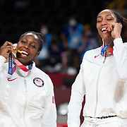 TOKYO, JAPAN August 8:  Chelsea Gray #8 of the United States and A'ja Wilson #9 of the United States with their gold medals at the medal presentation after the Japan V USA basketball final for women at the Saitama Super Arena during the Tokyo 2020 Summer Olympic Games on August 8, 2021 in Tokyo, Japan. (Photo by Tim Clayton/Corbis via Getty Images)