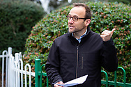 The Federal Greens Leader Adam Bandt speaks to the media at the entrance of 12 Sutton Street North Melbourne after a failed attempt to drop multi lingual leaflets into the the mailboxes of residents in that tower to help them understand why they were forbidden to leave their units amid a full and total lockdown of 9 housing commission high rise towers in North Melbourne and Flemington during COVID-19 on 5 July, 2020 in Melbourne, Australia. After 108 new cases where uncovered overnight, the Premier Daniel Andrews announced on July 4 that effective at midnight last night, two more suburbs have been added to the suburb by suburb lockdown being Flemington and North Melbourne. Further to that, nine high rise public housing buildings in these suburbs have been placed under hard lockdown for a minimum of five days, effective immediately.  Residents in these towers will not be allowed to leave their units for any reason. Police will be stationed at every entry and exit point, every level, and they will also surround these locations preventing any movement in, or out. There is a total of 1354 units and over 3000 residents living in these buildings including the states most vulnerable people. These new restrictions will remain in place for fourteen days with fears of further lockdowns to come. The Government have stressed that if Victorians do not follow the basic COVIDSafe rules, the whole state will go back in to lockdown. (Image by Dave Hewison/ Speed Media)