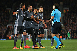 31st October 2017 - UEFA Champions League - Group A - Manchester United v SL Benfica - Benfica players Jardel (L), Andreas Samaris (2L), Eduardo Salvio (2R) and Ruben Dias (R) complain to referee Gediminas Mazeika after he awarded a penalty - Photo: Simon Stacpoole / Offside.