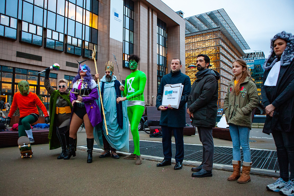 """As EU Fisheries Ministers gather today in Brussels to set fishing levels for the North East Atlantic for 2020, 13-year-old Farrah Delrue and 10-year-old Josephine Seton - representing current and future generations - presented European Commissioner for Environment, Oceans and Fisheries Virginijus Sinkevičius with more than half a million signatures from EU citizens who are calling for an end to overfishing by EU member states. EU Member states are required to end overfishing by 2020, under the Common Fisheries Policy (CFP). <br /> <br /> <br /> The Ocean Avengers, a team of superheroes embodying the ocean, climate, law, science and the will of EU citizens, attended the handover, urging Commissioner Sinkevičius to convey the message """"Ending overfishing IS Climate Action"""" to AGRIFISH ministers, and they must obey the law by setting fishing limits within scientific advice, in order to reduce one of the biggest threats to the ocean and its capacity to support life on the planet."""