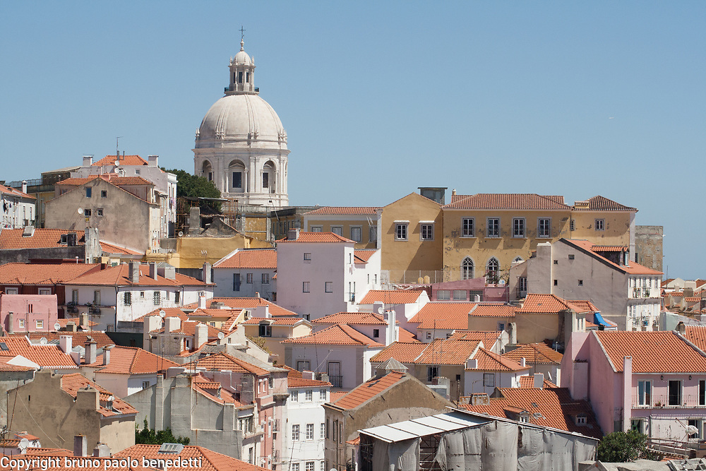 glimpse over Lisbon roofs and church particular in Alfama