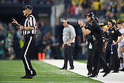 Oregon Ducks head coach Mark Helfrich encourages his team against the Ohio State Buckeyes during the College Football Playoff National Championship Game at AT&T Stadium on January 12, 2015 in Arlington, Texas.  (Cooper Neill for The New York Times)