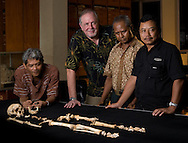 """Dr. William Jungers, Rokhus Due Awe, Thomas Sutikna and Sonny admire """"LB1"""", the type specimen skeleton of Homo floresiensis, a.k.a., the Flores hobbit."""
