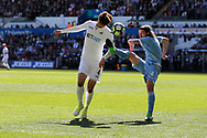 Ki Sung-Yueng of Swansea city is challenged by Joe Allen of Stoke city. Premier league match, Swansea city v Stoke City at the Liberty Stadium in Swansea, South Wales on Saturday 22nd April 2017.<br /> pic by Andrew Orchard,