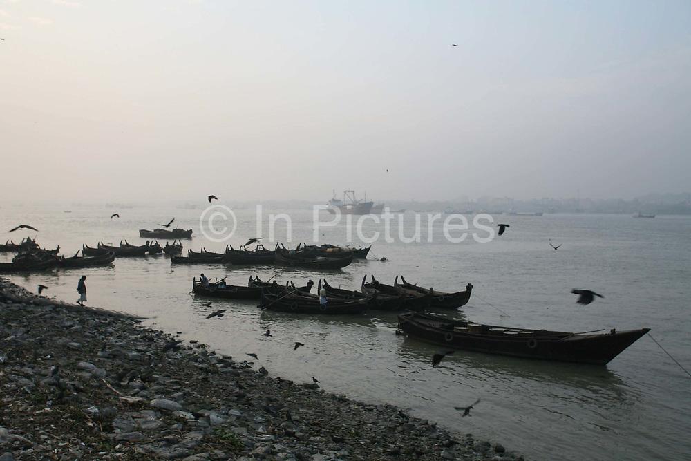 Boats (sampan) on the southern shore of the Karnaphuli River, Chittagong, Bangladesh